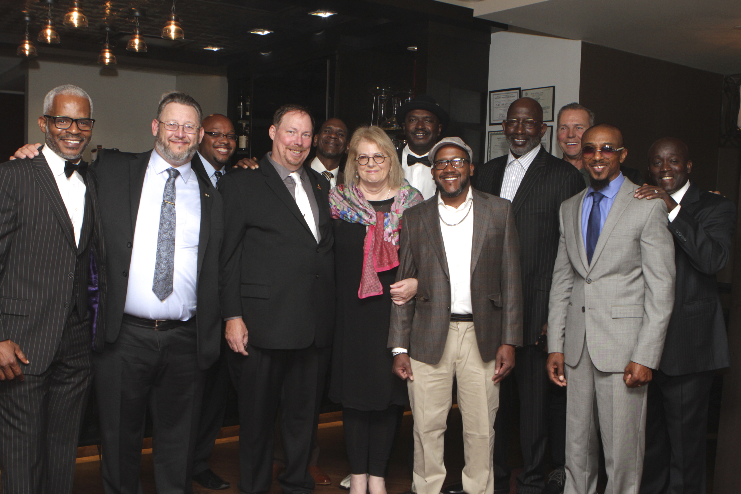 Centurion Executive Director Kate Germond with exonerees from across the country